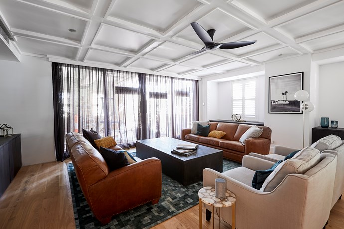 """**Living room** - The couple's living room was initially compared to a """"90s boardroom"""" by Shaynna Blaze. So when it came to [redo room week](https://www.homestolove.com.au/the-block-2018-redo-rooms-before-and-after-19074 target=""""_blank"""") this is the space Kerrie and Spence honed in on. Kerrie swapped out some of the bland artworks and added quirky homewares, much to Shaynna's delight."""