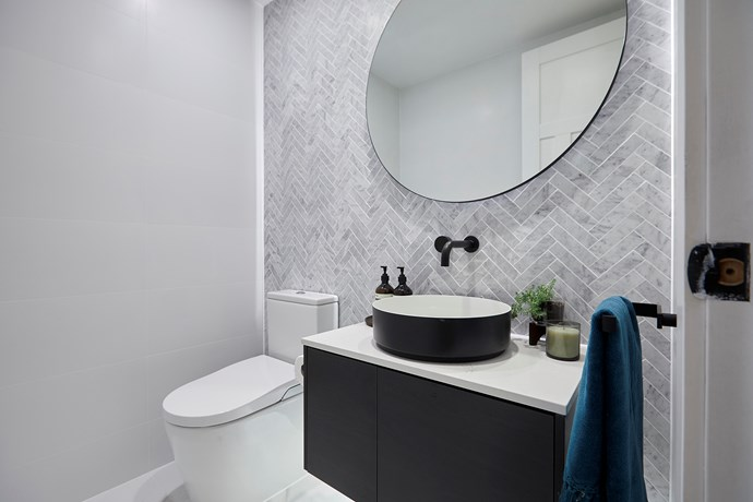 """**Powder room** - The couple's [powder room](https://www.homestolove.com.au/whats-your-powder-room-style-4-chic-and-functional-spaces-we-love-15101 target=""""_blank"""")  was a hit with the judges. They particularly loved the layout which conceals the toilet from view upon entry."""