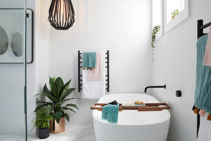 """**Main bathroom** - It was a miracle that Kerrie and Spence managed to complete their main bathroom, as the pair's insistence on tiling the space themselves eventually backfired. Luckily, [Carla and Bianca's](https://www.homestolove.com.au/bianca-and-carla-the-block-2018-7017 target=""""_blank"""") tiler helped them out at the last second to deliver a functional space with an exceptional layout that was lacking only in personality and 'wow-factor.'"""