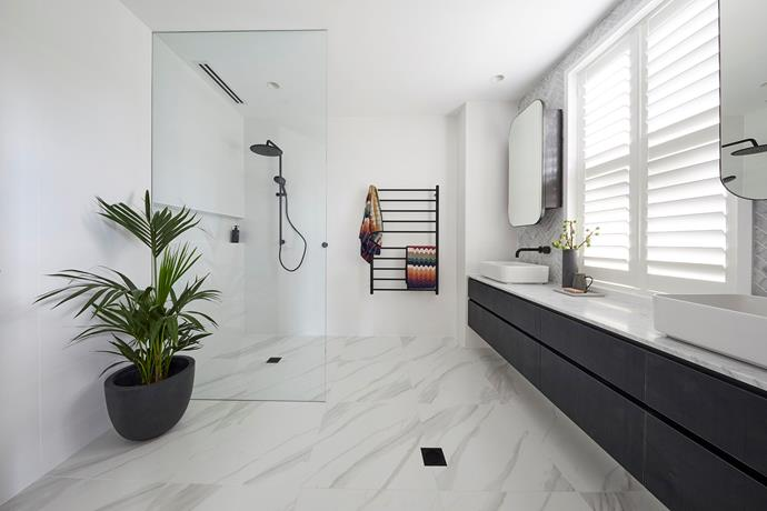**Master ensuite** - What this ensuite lacked in size, it sure made up for in style, functionality and finish. It was Kerrie and Spence's attention to detail - and luxurious herringbone marble tiles - that nabbed the couple the room win.