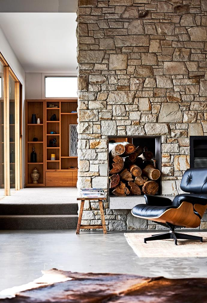 **Fireplace** A feature fireplace has been built into the stone wall in the living area.