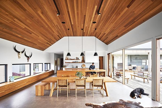 "**Kitchen and dining area** Blackbutt joinery evokes a lodge-like feel, along with a 'Farmhouse' dining table and 'Warehouse' bench seat, both from [Mark Tuckey](https://www.marktuckey.com.au/|target=""_blank""