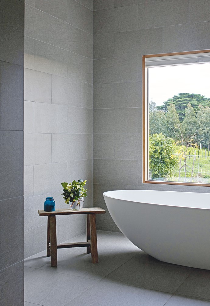 **Ensuite** Pamper time is bliss in a 'Lucia' freestanding stone bath from ACS Bathrooms, positioned to take in the picturesque view.  The 'Basaltina' matt wall and floor tiles in Pietra are from Walkers in Geelong.
