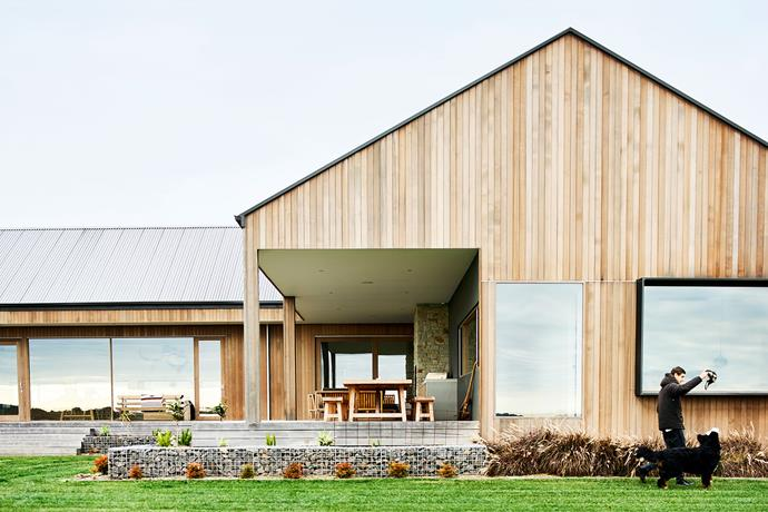 "**Exterior** Builder Matt suggested using western red cedar for the cladding. ""It handles extremes of weather well and will grey off and look like an old farmhouse,"" says Stuart. Rocks from the local quarry were used for the gabion walls in the garden. 'Spandek' roof cladding in Monument, [Colorbond](https://colorbond.com/