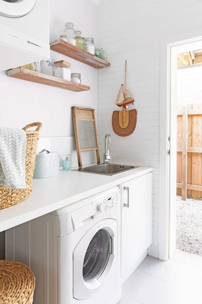 A bland white laundry can be brought to life by adding warmth through baskets and timber accessories. *Photo: Angelita Bonetti / bauersyndication.com.au*