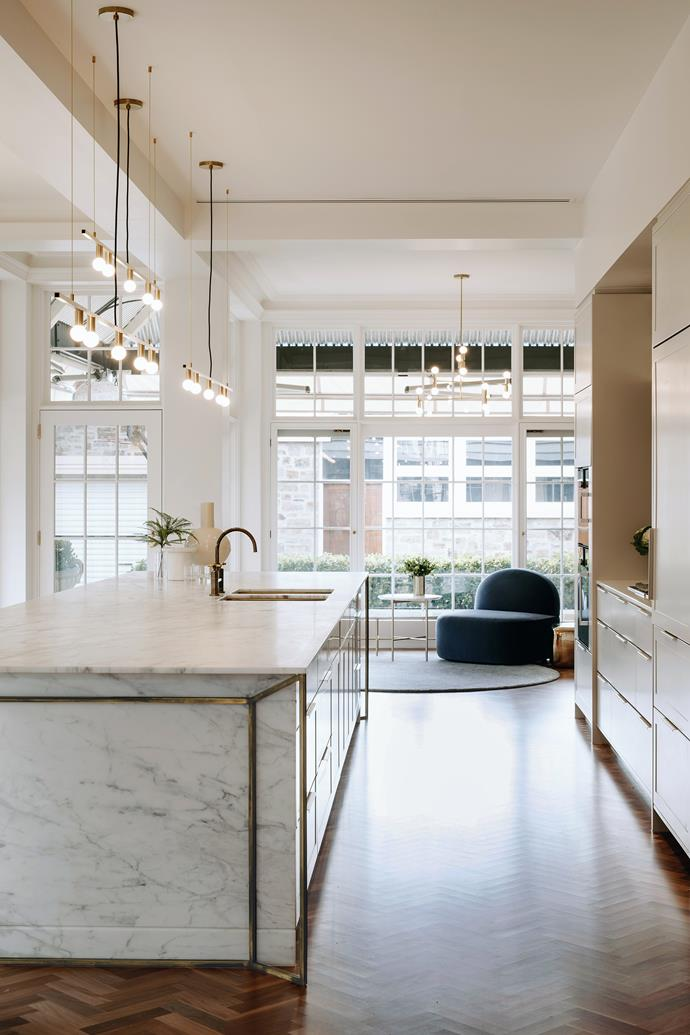 """**'Glow & glamour' by [Williams Burton Leopardi](https://designbywbl.com.au/ target=""""_blank"""" rel=""""nofollow""""):** Marble and aged-brass highlights are luxurious touchpoints in this kitchen.The brief was for a relaxed, functional and flexible kitchen that would also reflect the refined glamour of the heritage Adelaide home. What was once a dated '80s kitchen with no connection to the adjacent living area is now a spacious gathering place with a generous central island bench as the hero. """"The island bench takes pride of place and is a breathtaking focal and talking point,"""" says owner Dora. """"The unique detailing creates a dramatically elegant space and we absolutely love the end result."""" *Photo:* Christopher Morrison"""