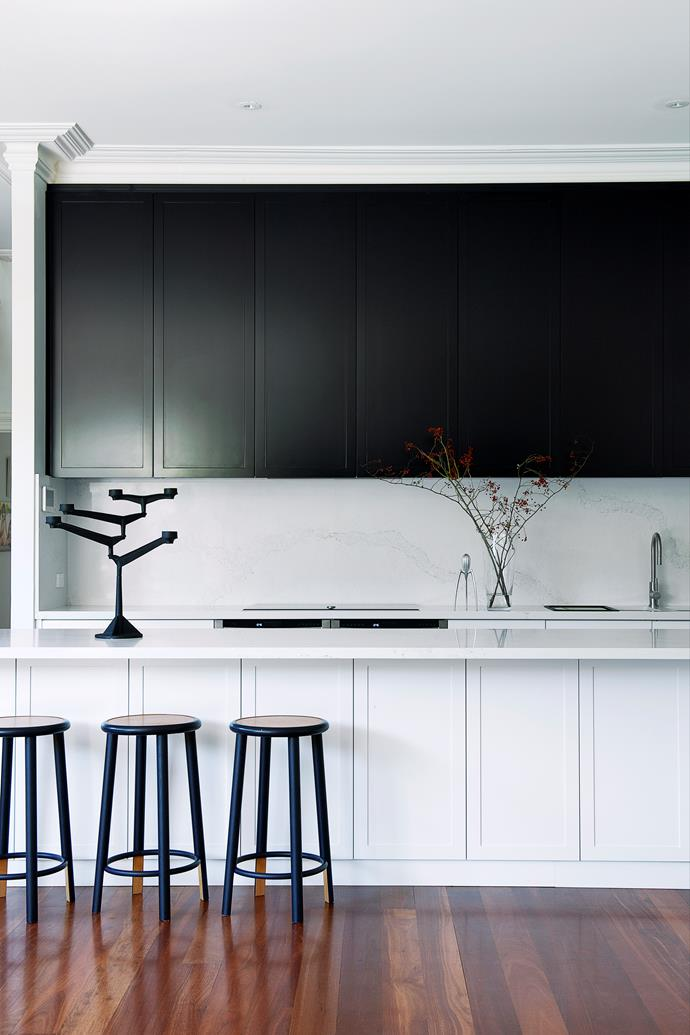 """**'New heights' by [Emma Hann Interiors](http://emmahanninteriors.com.au/ target=""""_blank"""" rel=""""nofollow""""):** In a circa-1900 Perth house, a large kitchen footprint and lofty 3.2m ceiling allowed for generosity of scale in this new layout, to the delight of an owner who loves to cook. Upper cabinets stretch to a height of 1.5m and the Caesarstone bench is 3.4m long, with 18 oversize drawers and four cupboards underneath. Equally important are the concealed features: open storage and other appliances were moved to a scullery off to the right. Even the fridge was installed in the scullery to preserve the tailored look of the cabinetry. """"We love the flexibility of this space,"""" enthuses the owner. """"It works effortlessly as a kitchen and as a welcoming place for friends and family."""" *Photo:* Jody D'Arcy"""