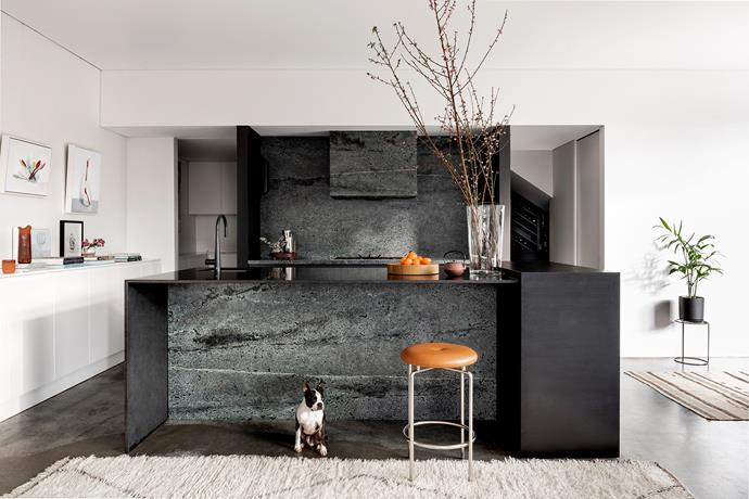 """**'Vein of riches' by Simone Robeson of [Robeson Architects](http://www.robesonarchitects.com.au/ target=""""_blank"""" rel=""""nofollow""""):** """"Low-maintenance and minimal"""" was the goal for the busy young family that resides in this home. Open and flexible, the interior plan is oriented to a northern aspect and pool. Dark cabinetry and honed concrete floors work beautifully with the serene kitchen's black-green granite. """"The slabs of stone had been sitting in the factory for a while as the unusual colour wasn't that popular,"""" says architect Simone Robeson. """"It was a great find because it suits the palette perfectly. I love the consistent veining across the splashback and rangehood."""" Dark cabinetry extends into the rear cellar, while a rear pantry and coffee area remove the need for overhead storage. *Photo:* Dion Robeson"""