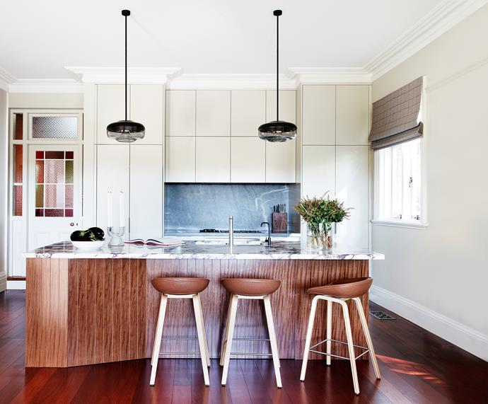 """**'Time traveller' by [Brett Mickan Interior Design](http://bmid.com.au/ target=""""_blank"""" rel=""""nofollow""""):** The owners of this Federation-era Sydney home faced a common renovation dilemma: how to create a [contemporary kitchen](https://www.homestolove.com.au/contemporary-kitchen-inspiration-7036 target=""""_blank"""") that works in harmony with heritage architecture? Brett's streamlined scheme bridges both worlds with fully integrated appliances and natural materials such as timber, marble and leather. V-grooved brushbox veneer wraps the angular island and is teamed with richly veined marble benchtops, a bluestone-lined splashback and lights made from handblown glass and leather. """"It all feels natural and looks like it belongs to the home,"""" says Brett. Owner Lissa agrees. """"Brett has created a wonderfully warm heart to our home."""" *Photo:* Thomas Dalhoff"""