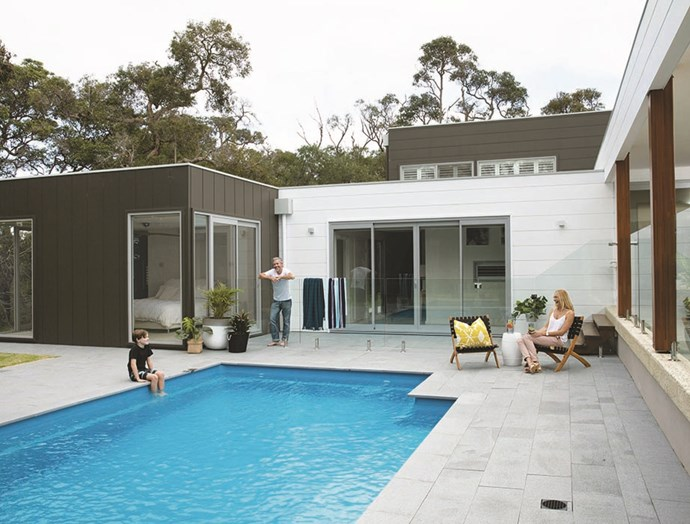 The mixed orientation of the Stria Cladding helps to draw the eye towards the statement features of the house such as the pool and outdoor area. *Image / Supplied*
