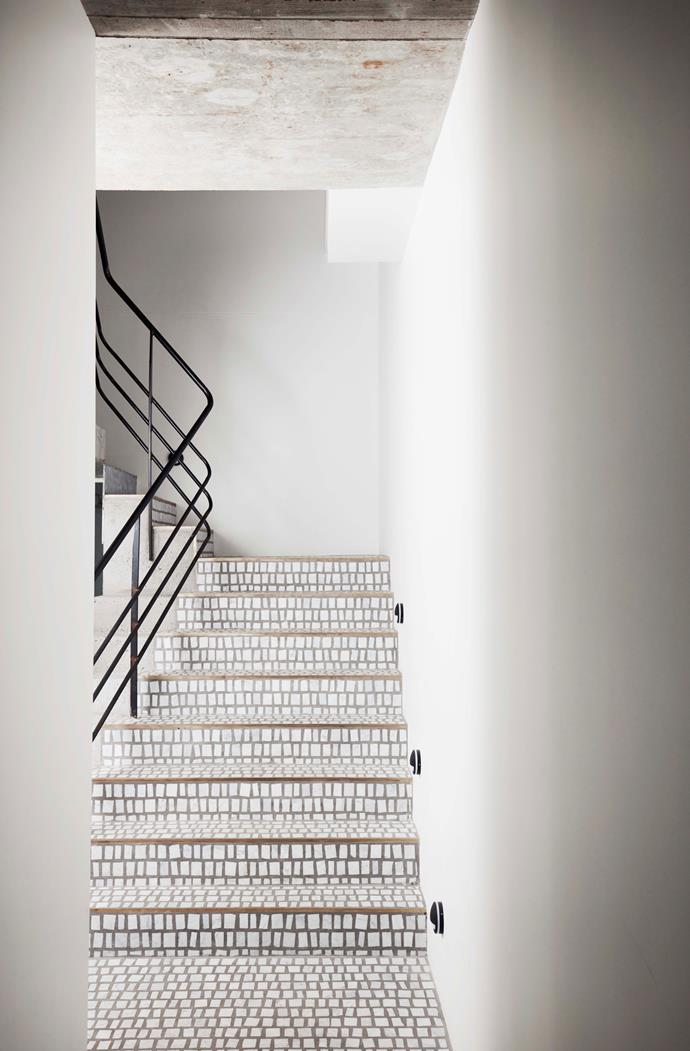 For the staircase, the Rossellis collaborated with Bisanna Tiles to create the sheeted marble mosaics.