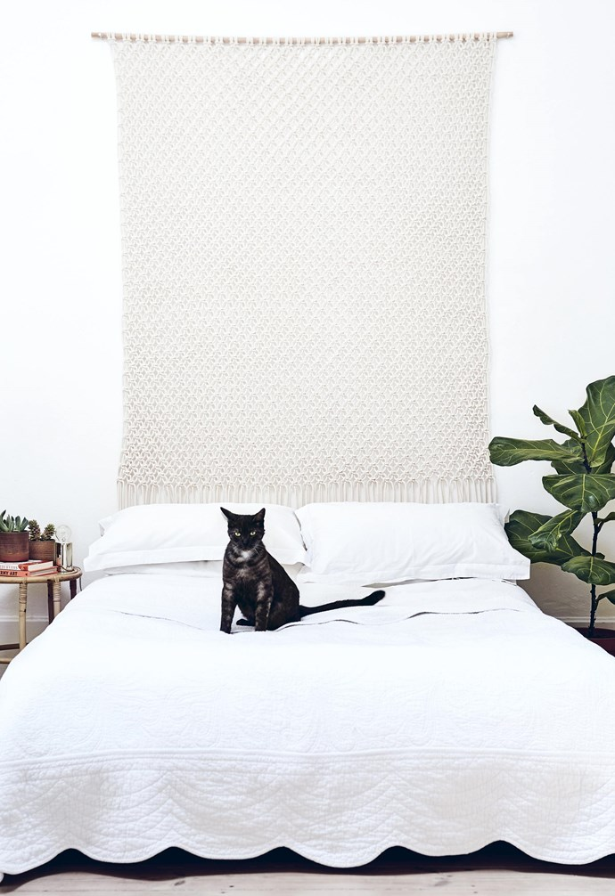 """**Just hanging out** A woven artwork adds character and texture to a space and is a great way to emphasise a specific area of focus. This pared-down bedroom gets the balance right for a [modern bohemian feel](http://www.homestolove.com.au/bohemian-interior-style-guide-4749