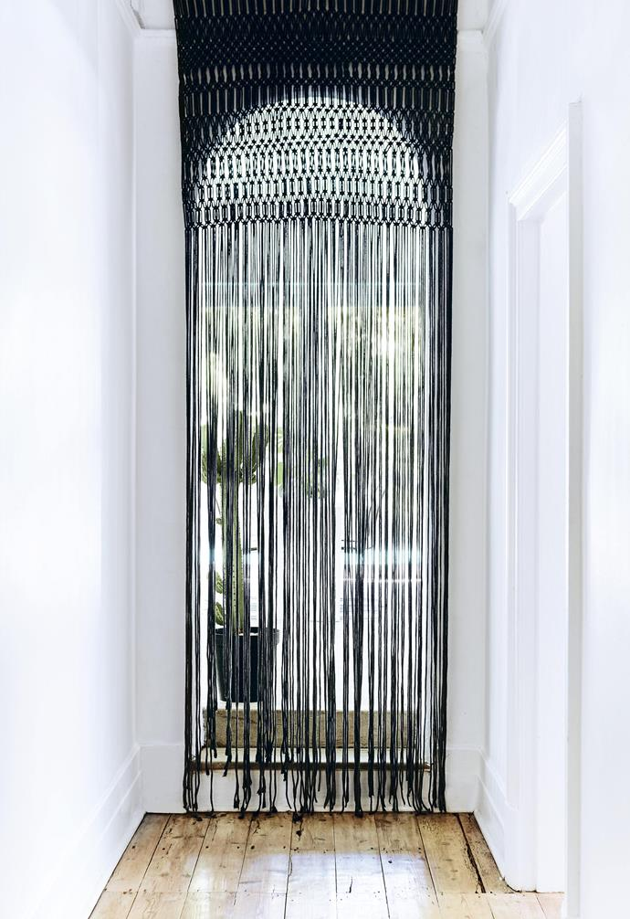 **Curtain call** A chic step up from beaded curtains, this macramé door hanging takes on a whole new life in sleek black. It's the perfect option for defining open-plan spaces, softly diffusing sunlight or as a window covering.