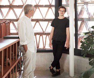 Father and son architects Luigi Rosselli and Raffaello Rosselli standing inside The Beehive in Surry Hills