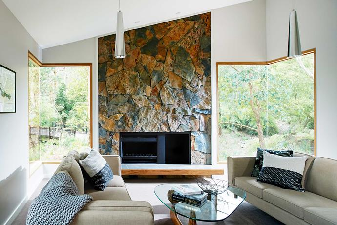 Slate surrounds the fireplace in the living room, seamlessly connecting the inside and out.