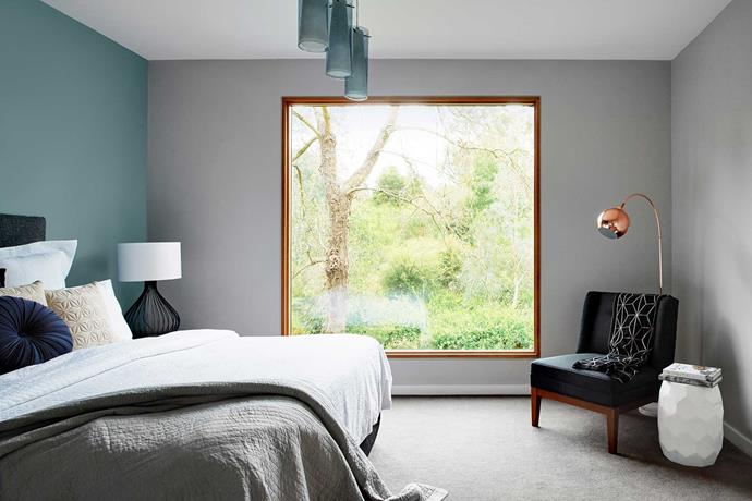 The centring of a square picture window in the main bedroom turns the tree view into a living artwork.