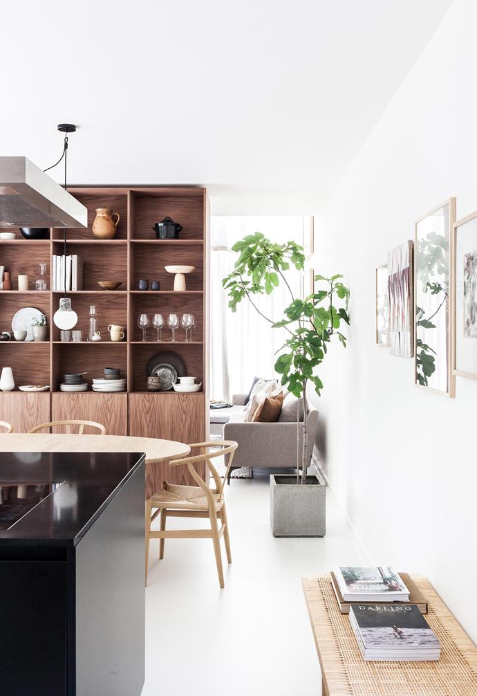 "**Dining area** A custom walnut cabinet sets different zones in the open floor plan and hides a metal structural cross beam. 'Bamboo' pendant light, Ay Illuminate, [Spence and Lyda](https://www.spenceandlyda.com.au/|target=""_blank""