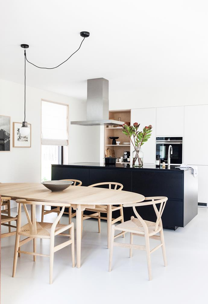 "**Kitchen**  Iconic 'Wishbone' chairs and a 'CH339' table in soaped oak, by Carl Hansen & Son, add warmth and texture. 'Mass' pendant light, [&tradition](https://www.andtradition.com/|target=""_blank""