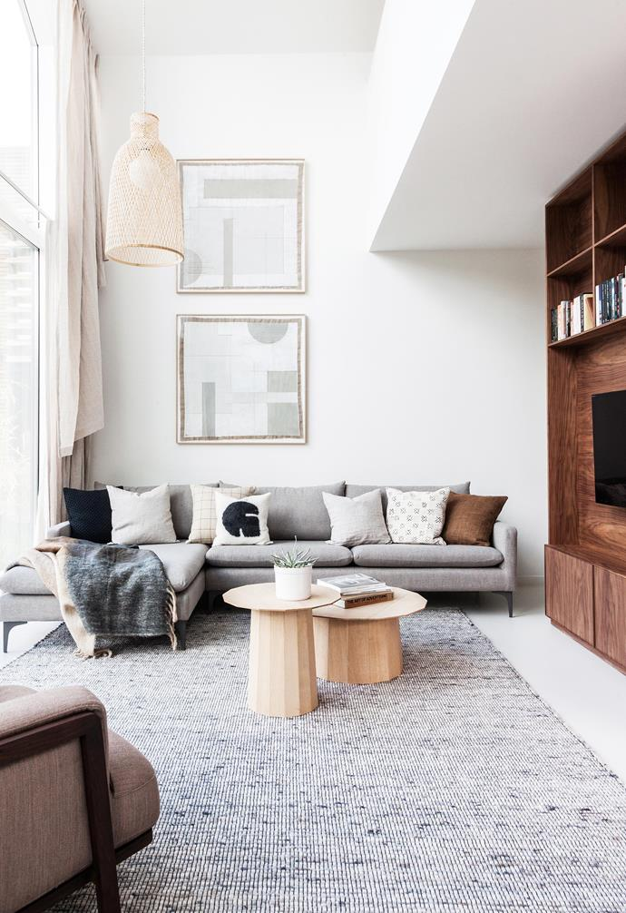 "**Living area** Dutch artist July Adrichem was commissioned to produce the two pieces of art. ""We wanted something striking and architectural, but at the same time subtle and detailed,"" says Stefan. ""We had the pieces mounted in floating oak frames."" The custom rug is by Avenue Design Studio. Grey cushions (on sofa), [My MÖlle](https://bymolle.com/