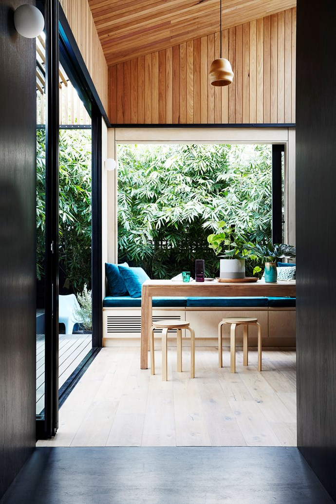 Owner/architect Michael had a clear design direction: to create a not-so-little pocket of calm in  the city. The upcycled dining table made from old floorboards is ideal for the bright, newly expanded space.
