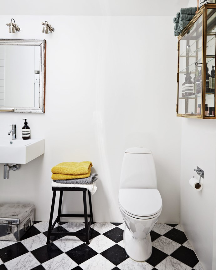 Chequered flooring adds interest to the bathroom in the annexe. The glass cabinet was found at an auction. Nearly every corner of the home was reworked to accommodate the family, with plenty of room to entertain larger numbers on a regular basis.