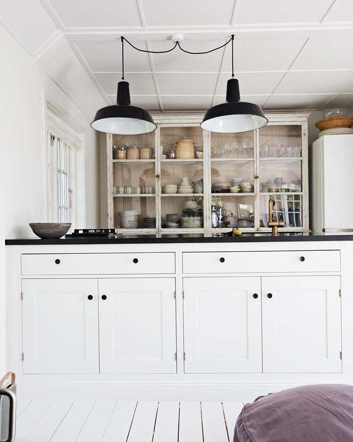 """Jette renovated the kitchen, installing a cabinet she bought at an auction and an island with a granite worktop. The Reluma industrial pendant lights are available in Australia from [Pamono](https://www.pamono.com.au/