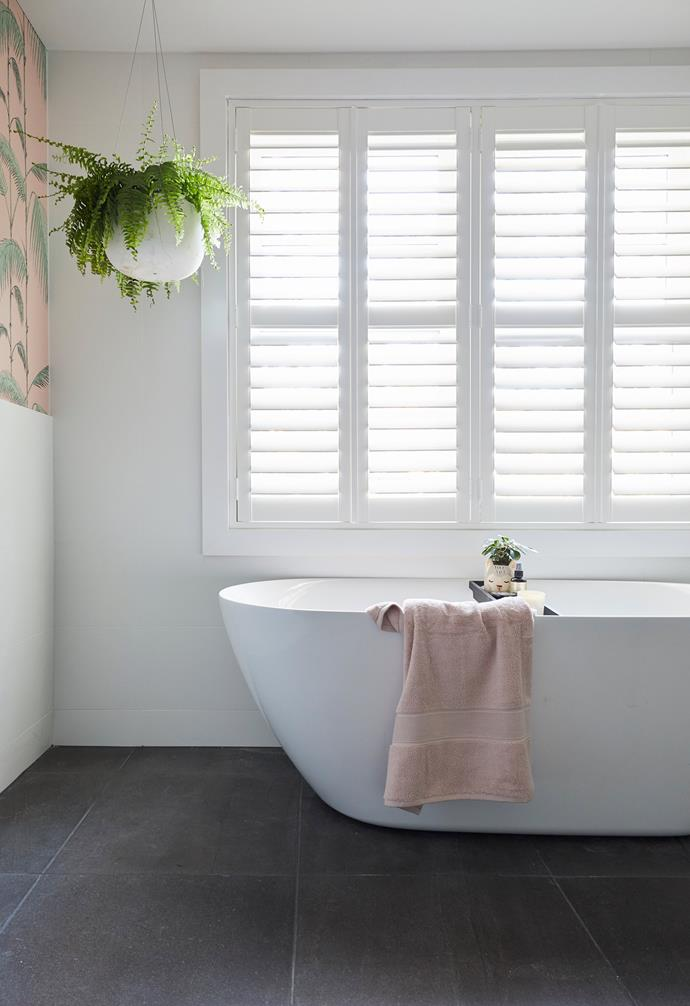 **Bianca and Carla** The sumptuous bathtub makes the most of its sunny position.