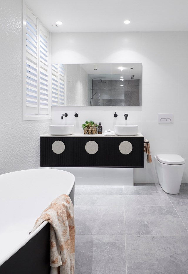 "Hayden and Sara steered clear of [brass bathtubs](https://www.homestolove.com.au/the-block-hayden-and-sara-brass-bath-18845|target=""_blank"") and expensive marble tiles in this main bathroom, instead opting for a refined monochrome palette that heros white, not black."