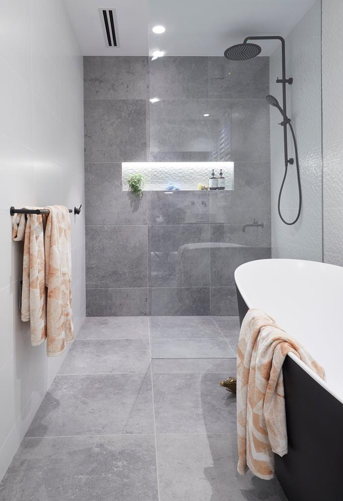 **Hayden and Sara** Elegant and refined, the bathroom made the most of its space.
