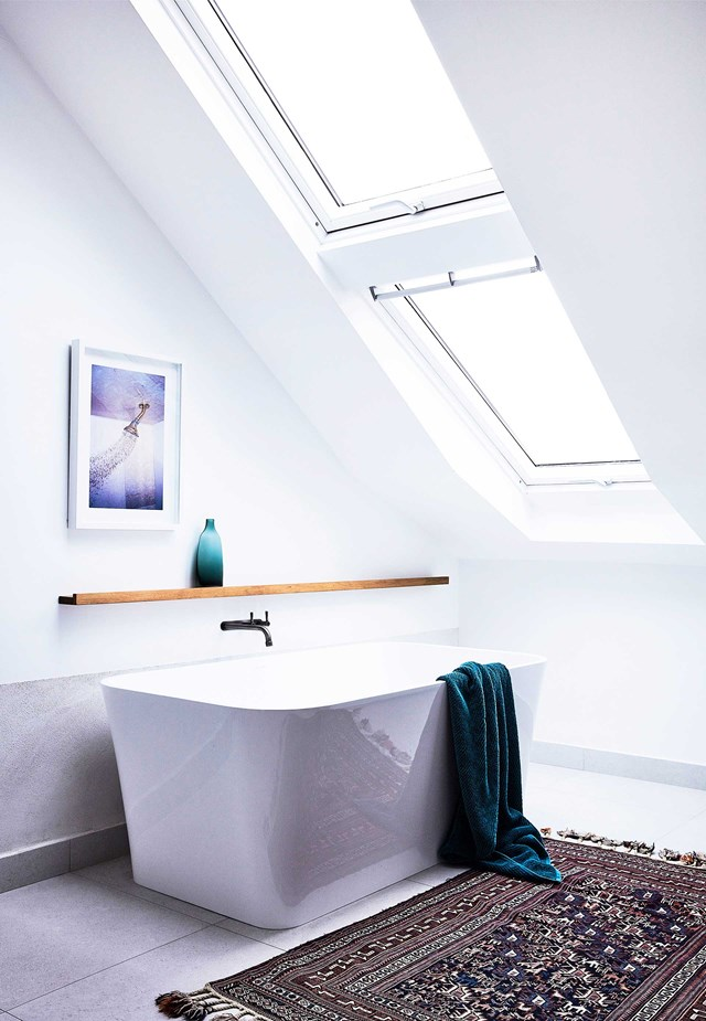 "Let there be light! The skylight-lit Victoria + Albert ""Edge"" bath provides the perfect place to relax and unwind. in this [Northern Beaches home](https://www.homestolove.com.au/northern-beaches-home-renovation-19164