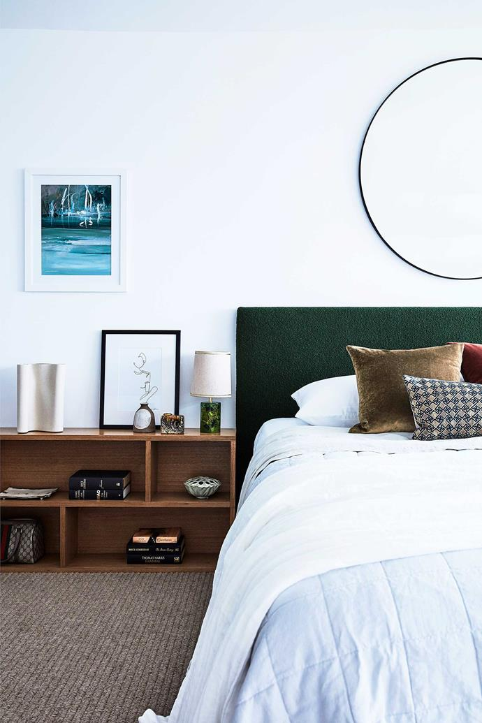 Kate Manning used green Redelman fabric to custom design the headboard. The green bedside lamp is from Vampt Vintage Design, while the artwork is by Gemma May Fitzgerald. The mirror above is from The Wood Room.