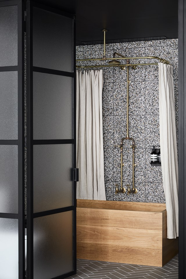 "Speckled terrazzo tiles form the perfect backdrop for this luxurious bathroom at [Paramount House Hotel](https://www.homestolove.com.au/bathroom-trends-inspired-by-boutique-hotels-19168|target=""_blank"") in Surry Hills. A timber soaking tub adds warmth to the otherwise industrial aesthetic. *Photo: Sharyn Cairns / Story: Real Living*"