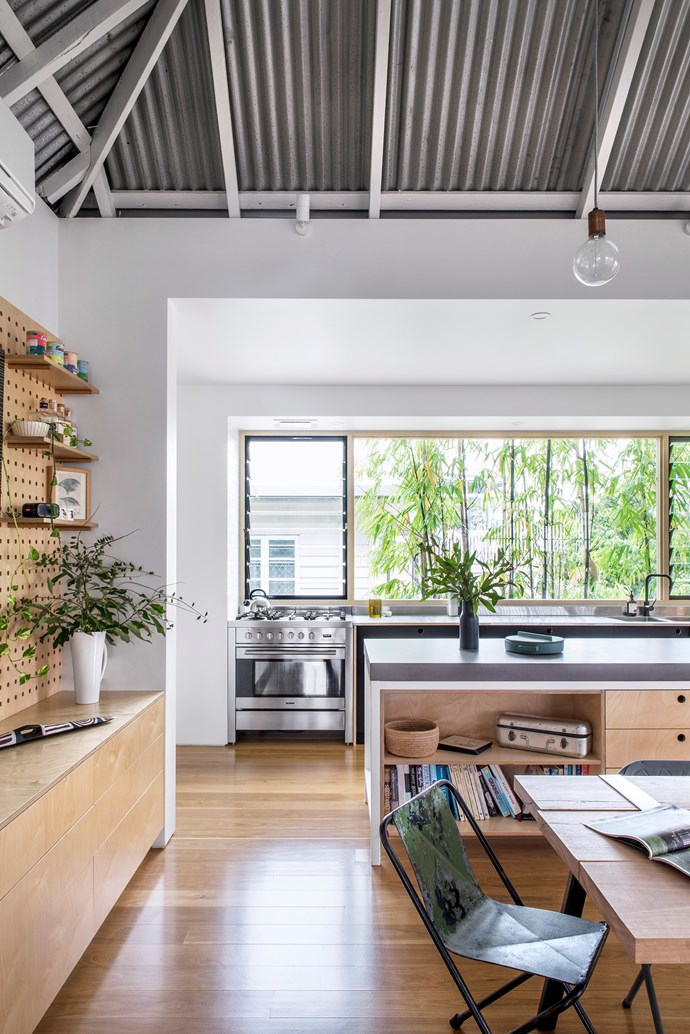 Bamboo outside the 4.5x1.8m glass splashback provides privacy and gives the room a treehouse feel. Louvres ensure airflow.