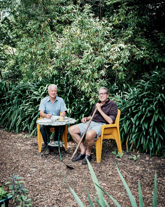Robert and Neal relax at a table in the garden. | *Photography: Michael Wee*