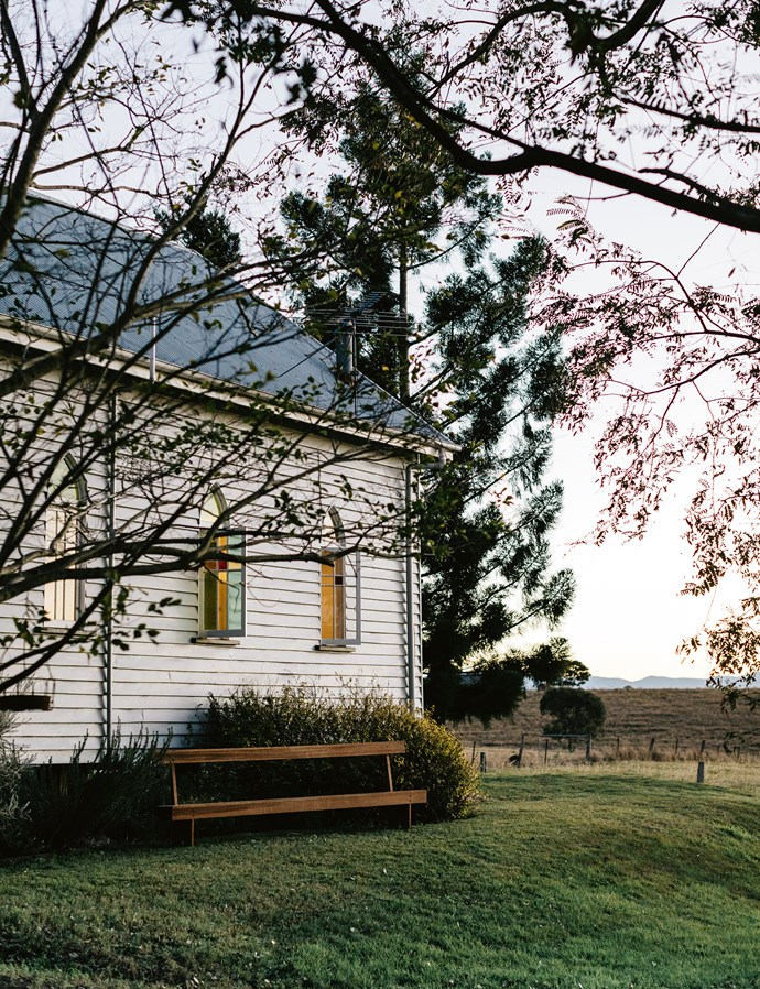 "This exterior of this [church-turned-family home](https://www.homestolove.com.au/restored-qld-church-full-of-divine-treasures-13984|target=""_blank"") was initially blue with burgundy and cream trim, so one of the family's first renovation tasks was to paint it Dulux Silkwort with Dulux Domino trim. Then they filled the interiors with divine treasures. 