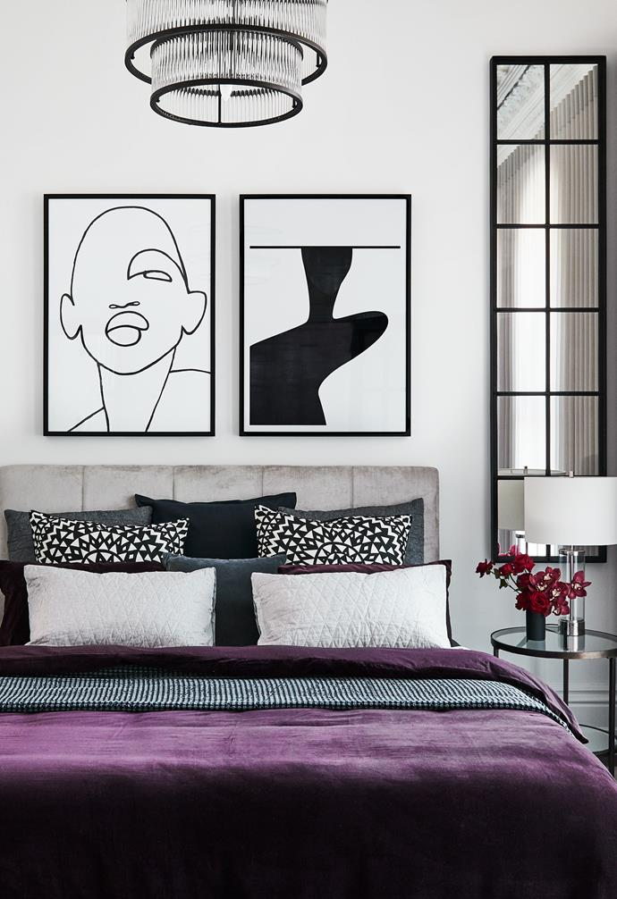 **Bedroom** The bold black lines of the artwork compliment the mirror to the side of the bed, and the fluted glass of the pendant light.