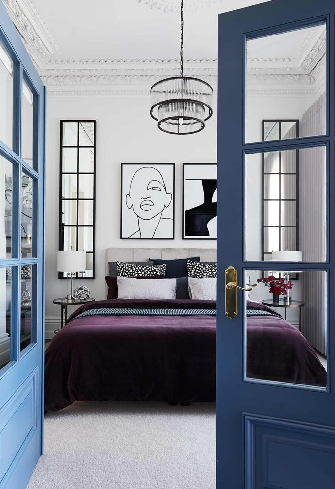**Bedroom** Striking blue doors separate the master bedroom from the rest of the home, adding a playful pop of colour.