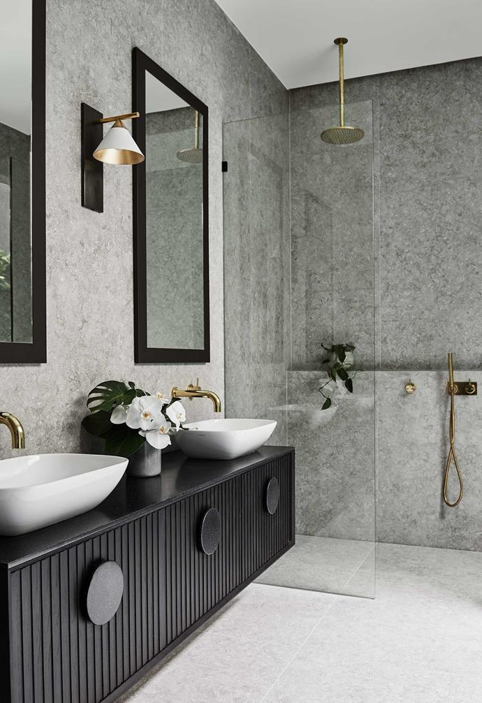 **Bathroom** Gold and black details warm up the bathroom.