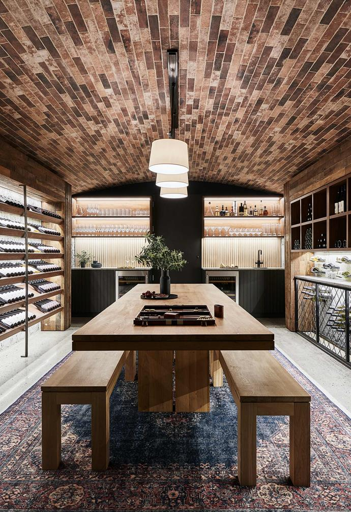 **Cellar** A gorgeous cellar and entertaining space adopts a rustic farmhouse aesthetic with the brick ceiling and industrial look.