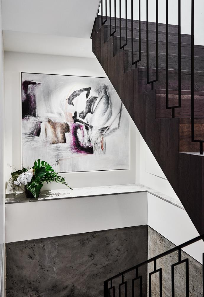 **Multi-level** Clever design in the staircase allows for a beautiful feature artwork and indoor plant to add a pop of colour in the usually neglected space.