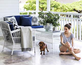 Woman and dachsund on a Hamptons style verandah