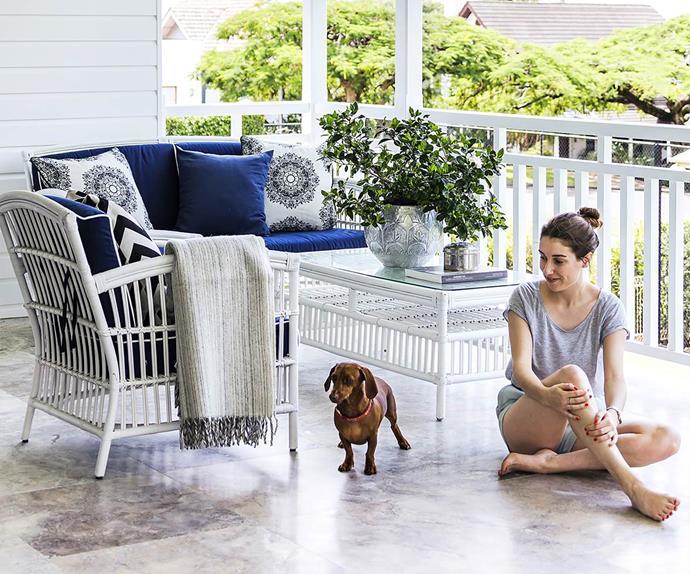 Woman and dachsund on a Hamptons style verandah