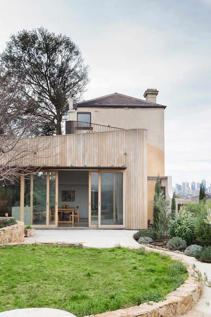 """The home's exterior and new extension inspired by Victorian era fashion features ruffle-esque railing on the roof terrace. The external cladding is silvertop ash. """"We wanted an extension that respected and responded to the home's history, including its quirks,"""" says Elizabeth."""