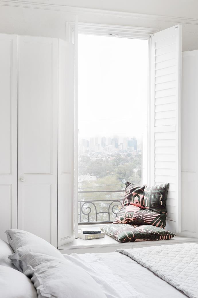 White, airy and bright the master bedroom's shutters open out, creating a neat reading nook. The wrought-iron balcony railing is a 1950s addition.