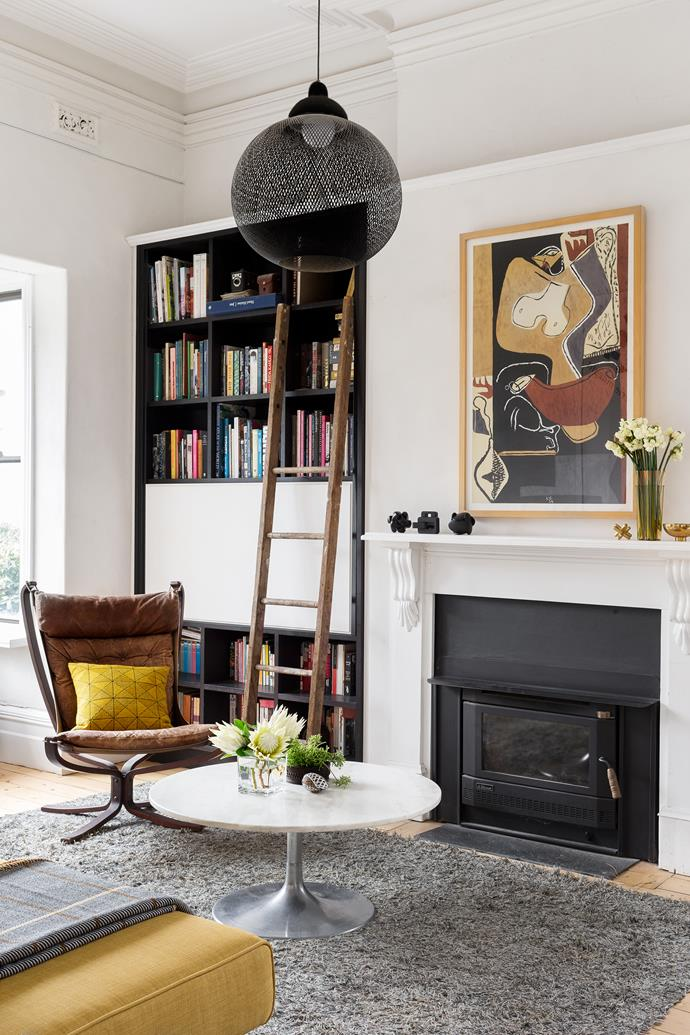 In the formal living room, an old ladder found in the garage is the perfect pairing for the 'library' by Michael Smith of CabinetSmith. The artwork is a Le Corbusier print.