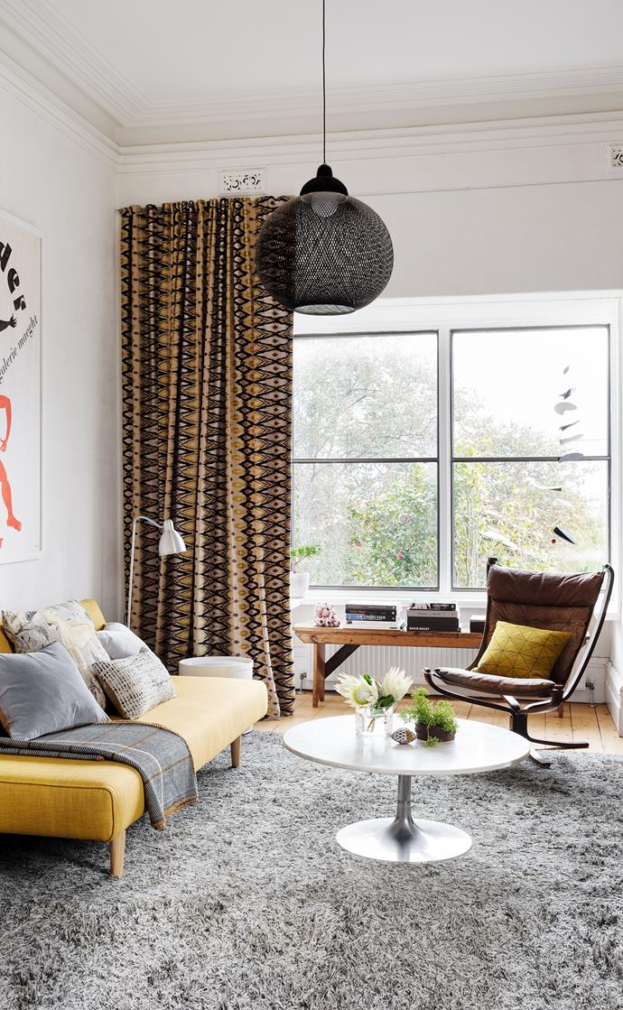 A smart sofa bed transforms this room from cosy sitting zone to guestroom in a flash. The Baltic pine floorboards are original; the steel-framed windows were added in the 1950s.