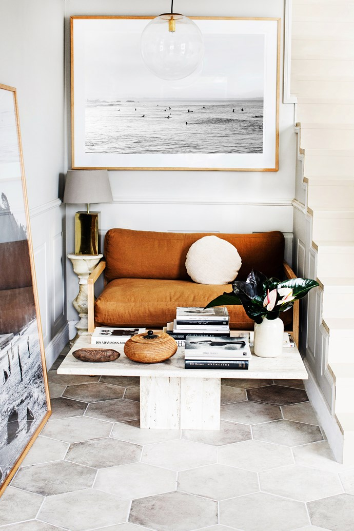 """Kara chose hexagonal tiles to make the entry space feel larger than it is. The tobacco-hued couch by father-daughter duo [Douglas & Bec](http://www.douglasandbec.com/ target=""""_blank"""") and travertine table found on Gumtree fit perfectly within her natural aesthetic."""