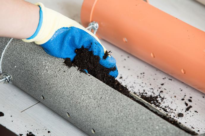 **Step 14: Fill with potting mix:** Place a small weed mat on the base of each pipe to cover the drainage holes. Now fill your pipes with potting mix. Make sure you are wearing gloves when handling potting mix.