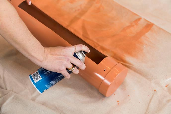 **Step 12: Prime & paint:** Prime your pipes and wait 20 minutes for the primer to dry. Then spray paint each pipe in your desired colours. Be sure to give your pipes 2-3 coats of paint for the best results.