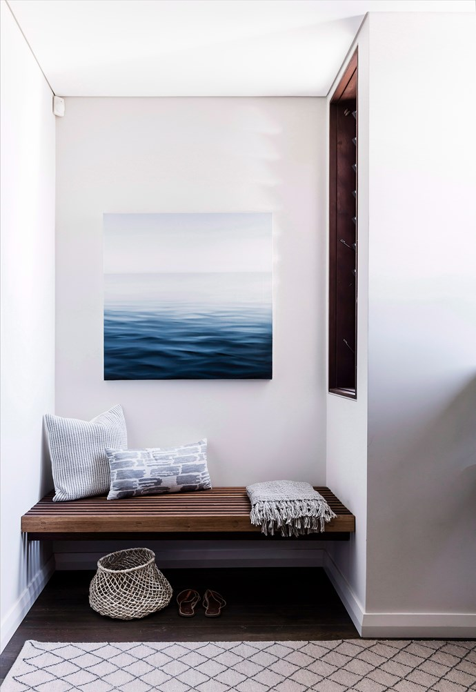 Art will always be a welcome addition to a hallway. This ocean-inspired artwork creates calm in this busy passageway. *Photo: Maree Homer / bauersyndication.com.au*
